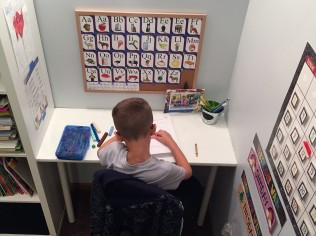 Using blocks to complete his math work